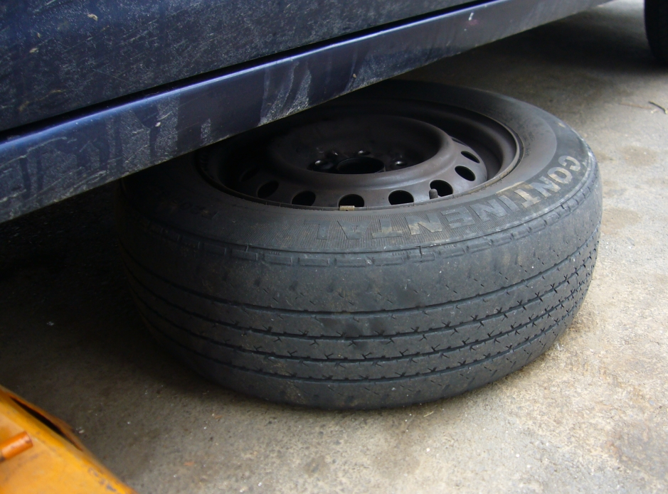 slide a wheel under the car in case of emergency